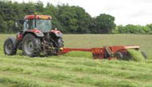 Tractor turning grass